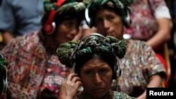 FILE - Indigenous women from the Ixil region attend a genocide trial in Guatemala City, May 9, 2013, for former Guatemalan president Efrain Rios Montt, who was accused of overseeing the killings of nearly 2,000 members of the Maya Ixil population during the country's civil war.