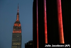 Orange lighting illuminates the Empire State Building in recognition of Gun Violence Awareness Month, Wednesday, June 1, 2016, in New York.