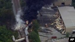 This image provided by WBAL-TV, shows a train derailment outside Baltimore on May, 28, 2013
