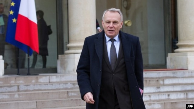 FILE - Then-French Prime Minister Jean-Marc Ayrault leaves the Elysee presidential Palace in Paris, Jan. 10, 2013.