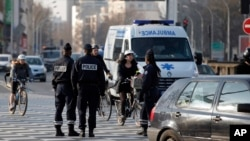 FILE - Police officers in Paris, France, Monday, March 23, 2015.