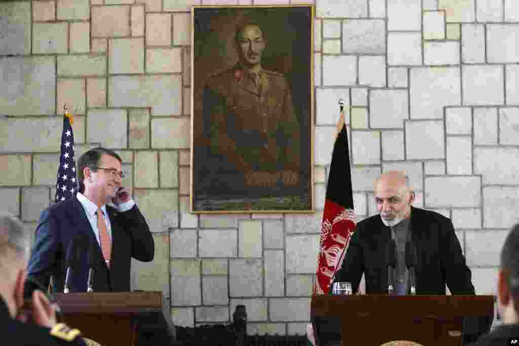 U.S. Defense Secretary Ashton Carter listens to remarks by Afghan President Ashraf Ghani during a news conference at the Presidential Palace in Kabul, Feb. 21, 2015.