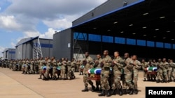 Members of the South Africa National Defence Force (SANDF) carry the mortal remains of 13 members that were killed in Central African Republic (CAR) during the handing over to the respective families at the Waterkloof Air Force Base, in Pretoria, March 28