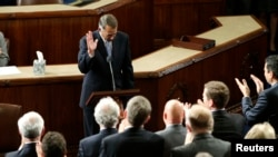 FILE - Outgoing House Speaker John Boehner departs the podium during a standing ovation after he addressed colleagues during the election for the new Speaker of the U.S. House of Representatives in the House Chamber in Washington, Oct. 29, 2015.
