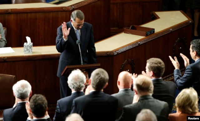 Outgoing House Speaker John Boehner departs the podium during a standing ovation after he addressed colleagues during the election for the new Speaker of the U.S. House of Representatives in the House Chamber in Washington, Oct. 29, 2015.