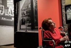 Holocaust survivor Veronica Phillips looks at her family portraits and memorabilia during the official opening of the Johannesburg Holocaust & Genocide Center and its permanent exhibition in Johannesburg, March 14, 2019.