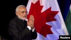 Prime Minister of India Narendra Modi speaks to a crowd during a dinner hosted by his Canadian counterpart Stephen Harper in Vancouver, British Columbia, April 16, 2015.