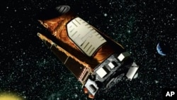 FILE - This artist's rendition provided by NASA shows the Kepler space telescope.