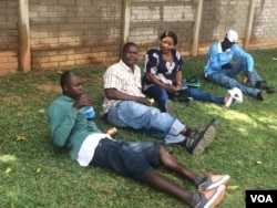 Some of the people waiting for ballot boxes at one of the polling stations.