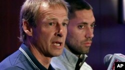 United States World Cup soccer team coach Jurgen Klinsmann, left, and team captain Clint Dempsey answer questions from the news media.