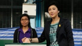 Thai Prime Minister and Pheu Thai party leader Yingluck Shinawatra poses before casting her ballot in the general election at a polling station in Bangkok, Thailand, Feb. 2, 2014.