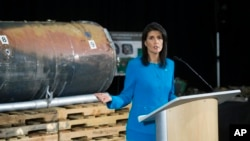 U.S. Ambassador to the U.N. Nikki Haley speaks in front recovered segments of an Iranian rocket during a press briefing at Joint Base Anacostia-Bolling in Washington, Dec. 14, 2017.