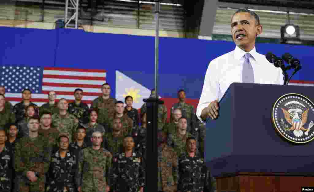 President Barack Obama speaks to military troops at Fort Bonifacio, saying a new military pact signed with the Philippines on Monday, April 27 granting a larger presence for U.S. forces would bolster the region's maritime security, Manila, April 29, 2014.