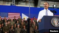U.S. President Barack Obama speaks to military troops at the Fort Bonifacio Gymnasium in Manila, Apr. 29, 2014.
