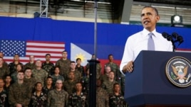 U.S. President Barack Obama speaks to military troops at the Fort Bonifacio Gymnasium in Manila, Apr. 29, 2014.