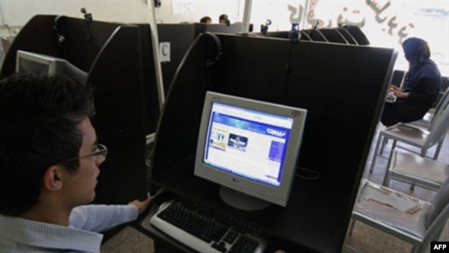 An Iranian youth browses a political blog at an internet cafe. The Iranian government has blocked the Iranian people from accessing thousands of websites.