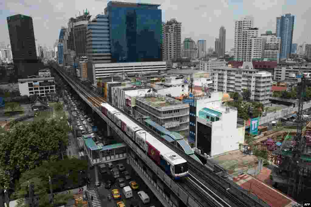 A BTS train (sky train) drives along a railway track in Bangkok, Thailand.