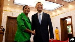 U.S. National Security Adviser Susan Rice, left, greets Chinese State Councilor Yang Jiechi at the Diaoyutai State Guesthouse in Beijing, China, Aug. 28, 2015.