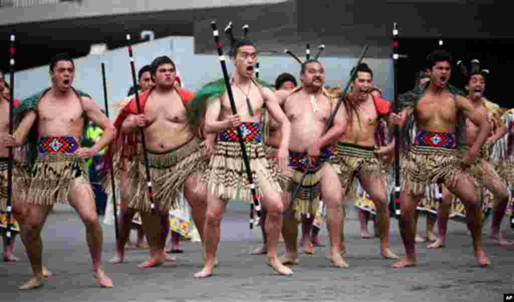 Dancers put on a traditional Maori welcoming ceremony for U.S. Secretary of State Hillary Rodham Clinton after arriving at the Parliament Complex Thursday, Nov. 4, 2010 in Wellington, New Zealand. (AP Photo/Evan Vucci)