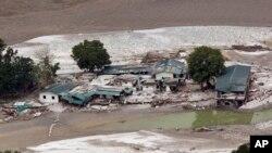 Damaged houses by River Ganges in Guptkashi, India, June 23, 2013.