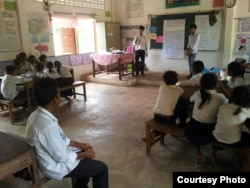 Thorn Bun Thoeng and his students are conducting an outreach program to raise awareness of sanitation and environmental protection at one of the local elementary schools in Preah Dak village, Siem Reap. (Courtesy Photo)