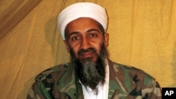 FILE - This undated photo shows al Qaida leader Osama bin Laden in Afghanistan.
