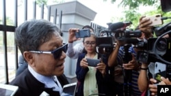 Khin Maung Zaw, a lawyer of two Reuters journalists, Wa Lone and Kyaw Soe Oo, talks to journalists as he leaves the Supreme Court in Naypyitaw, Myanmar, Tuesday, April 23, 2019. (AP Photo/Aung Shine Oo)
