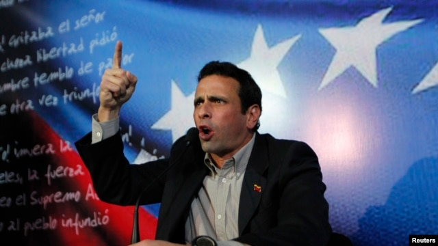 Henrique Capriles, Venezuela's opposition leader and governor of Miranda state, addresses the media in Caracas March 10, 2013.