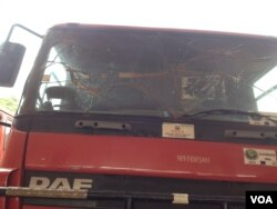 A nonoperational firetruck with a shattered window sits idle at the main fire station in Freetown, Sierra Leone, Jan. 25, 2016 (N. deVries/VOA)