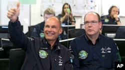 Swiss pilot and chairman of Solar Impulse Bertrand Piccard, left, gestures alongside Prince Albert II of Monaco as the solar-powered plane Solar Impulse 2 takes off from Nanjing, China, en route to Hawaii, at the Mission Control Center in Monaco, May 30,