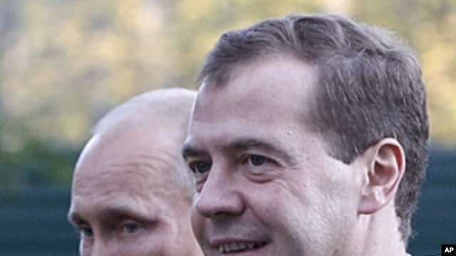 Russian President Dmitry Medvedev, right, and Prime Minister Vladimir Putin walk at the presidential residence in Zavidovo, about 150 kilometers (90 miles) north of Moscow, Russia.