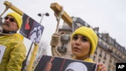 Iranian opposition protesters march during a rally to protest against executions in Paris, France.