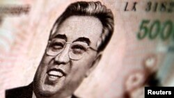 North Korean leader Kim Il-sung is seen on this 5000 North Korea won banknote in this photo illustration taken in Shanghai May 23, 2013.