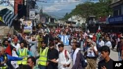 Supporters of Jammu Kashmir Liberation Front start marching toward the Line of Control, in Muzaffarabad, the capital of Pakistani Kashmir, Oct. 5, 2019.