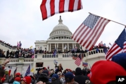 FILE - Supporters of President Donald Trump gather outside the US Capitol in Washington, Jan. 6, 2021.