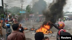 People burn tires during a protest at a road in Manokwari, West Papua, Indonesia, August 19, 2019.