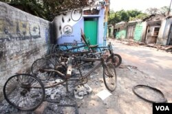A part of the Muslim locality in Telinipara with burned vehicles owned by Muslims. Hindu mobs set fire to the entire Muslim locality on May 12, during communal violence. (Shaikh Azizur Rahman/VOA)