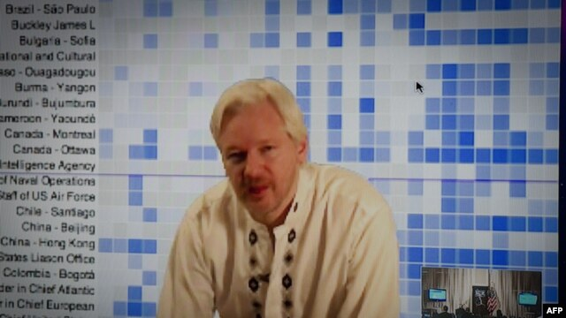 FILE - Julian Assange speaks during a teleconference between London and Washington.