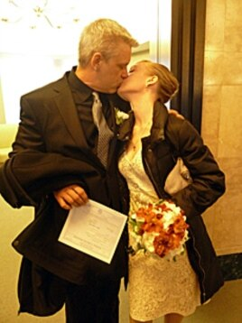 Just married! Ty and Elena kiss minutes after saying their vows. He is holding their wedding license.