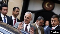 Iraq's fugitive Vice President Tareq al-Hashemi (3rd R) gestures as he leaves a meeting with Turkey's Foreign Minister Ahmet Davutoglu in Ankara September 9, 2012. Hashemi was sentenced to death for murder on Sunday in a ruling likely to further stoke sec