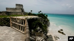 FILE - A view of ancient ruins along the Caribbean Sea in Tulum, Mexico, Aug. 20, 2007.