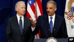 Vice President Joe Biden (left) with Attorney General Eric Holder April 9, 2013
