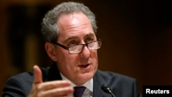 "FIILE - U.S. Trade Representative Michael Froman testifies before a Senate Finance Committee hearing on ""President Obama's 2015 Trade Policy Agenda"" on Capitol Hill in Washington, Jan. 27, 2015."
