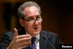U.S. Trade Representative Michael Froman, shown testifying before a Senate committee last month, says Froman says the Chinese textile, clothing, metal, chemical, medical product, building material and agricultural industries have benefited from illegal as