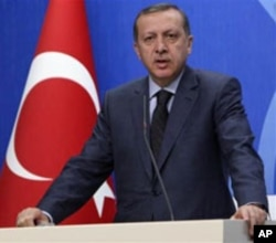 Turkish Prime Minister Recep Tayyip Erdogan speaks to the media during a news conference in Ankara, April 7, 2011