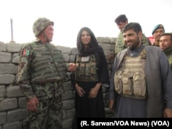 VOA journalist Ayesha Tanzeem visits a police checkpoint in Afghanistan's Achin district with Colonel Jan Mohammad, left, a local Afghan National Army commander, and Zabihullah Zmaray, right, a Nangarhar provincial council member.