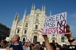 """Protesters rally in Piazza Duomo in Milan, Italy, July 24, 2021, against the introduction of a mandatory """"green pass"""" for indoor dining and entertainment areas aiming to limit the spread of the COVID-19."""
