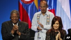 Argentina's President Cristina Fernandez, right, Antigua and Barbuda's Prime Minister Winston Baldwin, left, and Mexico's President Felipe Calderon, behind, applaud during the opening ceremony of the sixth Summit of the Americas in Cartagena, Colombia, Sa