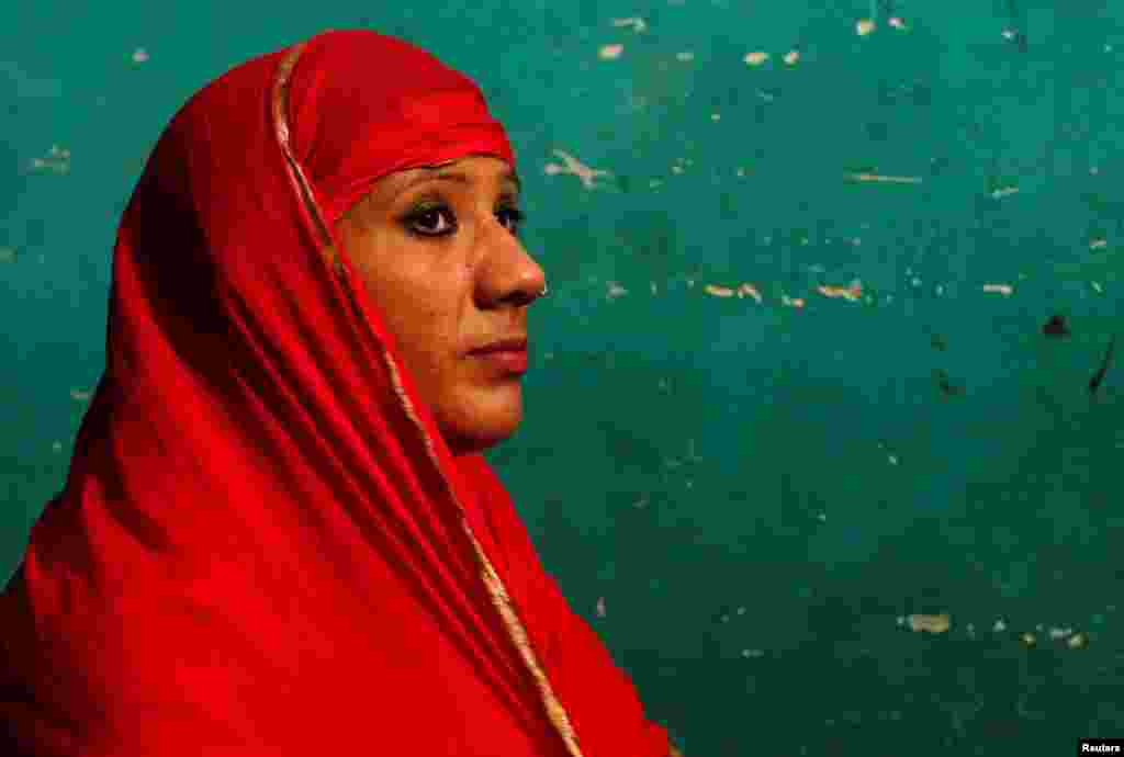 Bouncer Mehrunnisha Shokat Ali offers her evening prayer during holy month of Ramadan at her house in New Delhi, India.