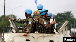 FILE - Peacekeepers serving in the United Nations Organization Stabilization Mission in the Democratic Republic of the Congo (MONUSCO) patrol in their armored personnel carrier, Dec. 20, 2016.